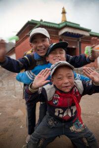 Tibetan kids in Xiahe, China by Mike Moss