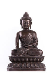 Buddha sitting on the lotus in a pose of a varada mudra